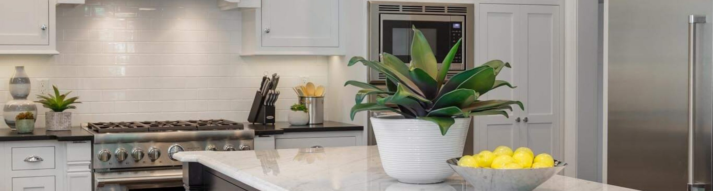 White kitchen cabinets with granite counter top