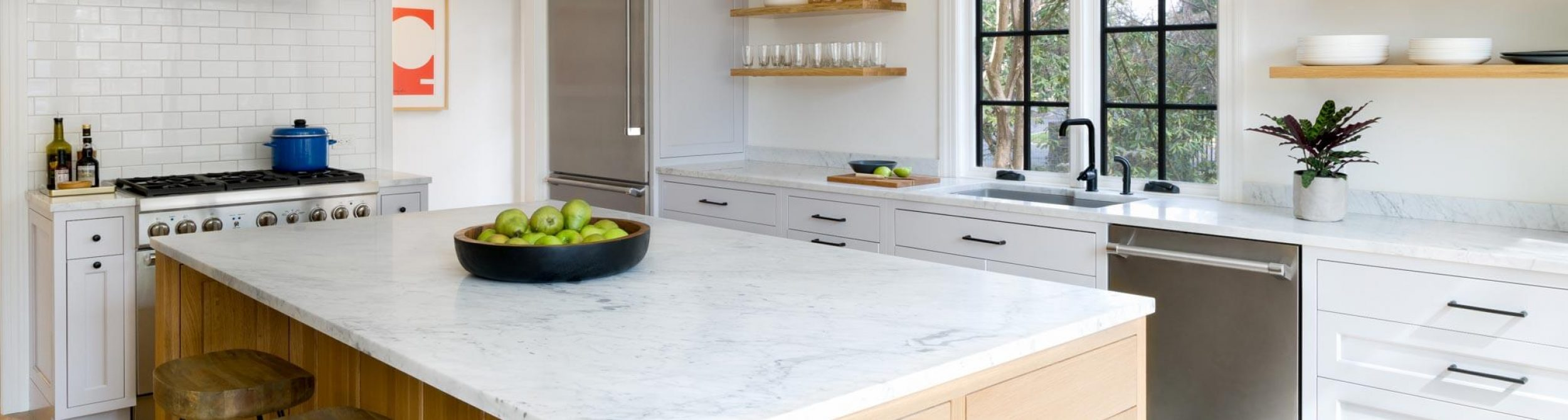 White kitchen with a granite counter top