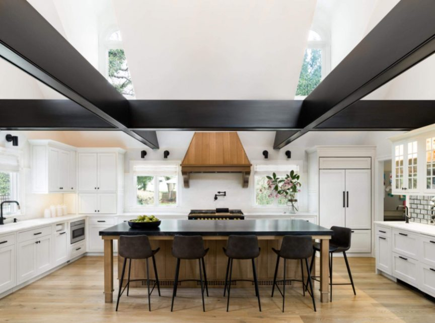 Island with a dark counter top in a kitchen